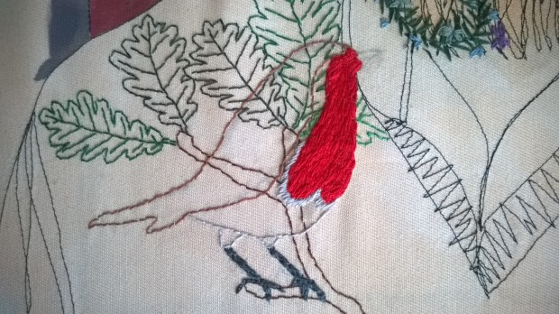Silk stitching the robin over yesterdays sewing!