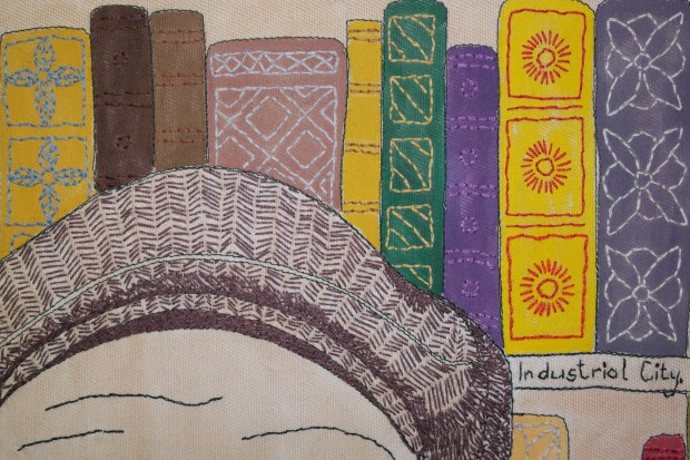 Portrait of a Green Man, detail of books and cap.