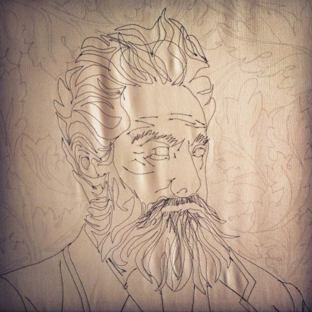 Acanthus leaves drawn onto the background of the finished sewn portrait.